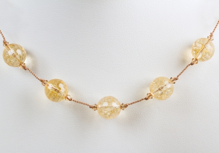 finesse: amber beads on the white Stock Photo