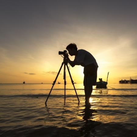 The Photographer takes a good shot on the Huahin  beach, Thailand photo