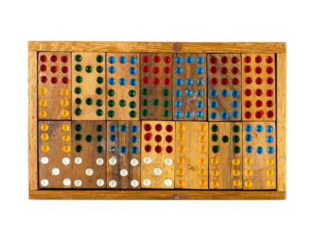 assemble: wooden square figures with color dots assemble in puzzle isolated