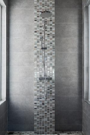 shower on tile wall Standard-Bild