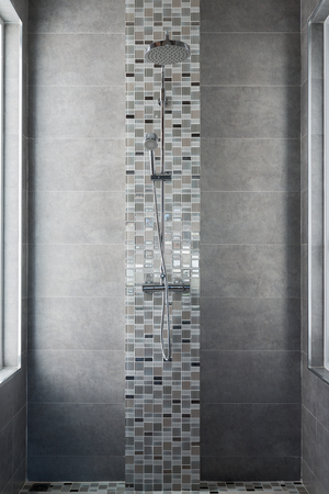 shower on tile wall Stock Photo
