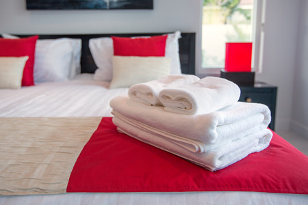 bath: Bath towels on the bed of hotel bedroom Stock Photo