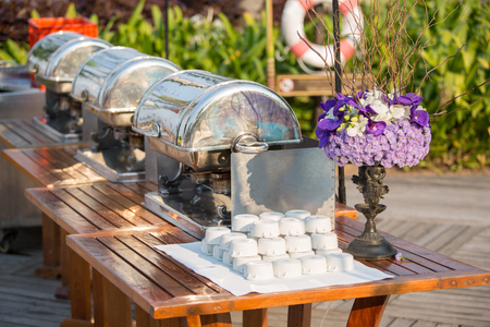 table linen: Buffet Table with Row of Food Service Steam Pans