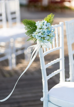 marrying: Close up of flower decorated on wedding chair