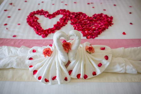 heart suite: two towel swans shaped on the bed,Honey moon bed Stock Photo
