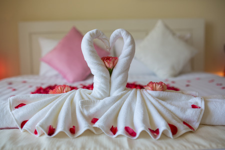 honey moon: two towel swans shaped on the bed,Honey moon bed Stock Photo