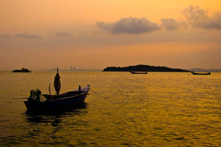 Little boats on the sea in twilight. photo