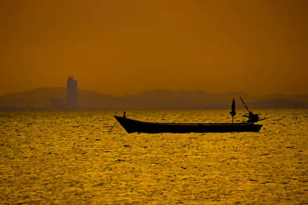 Boat on the golden sea. Stock Photo
