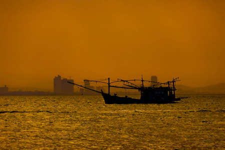 Fish hunting boat on the sea in twilight. Stock Photo - 8806305