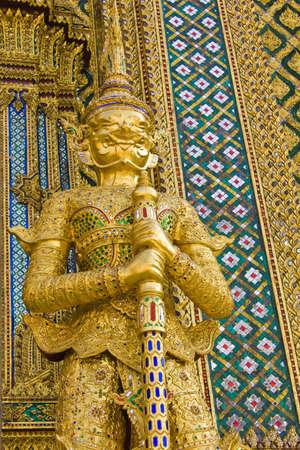 Golden guardian giant at Wat Phrakaew