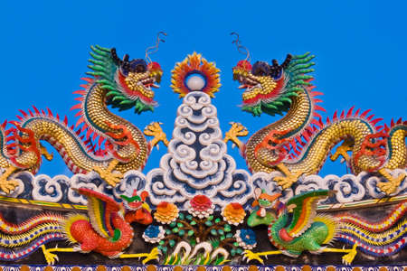 Double dragons & double swans on blue sky Stock Photo - 12030052