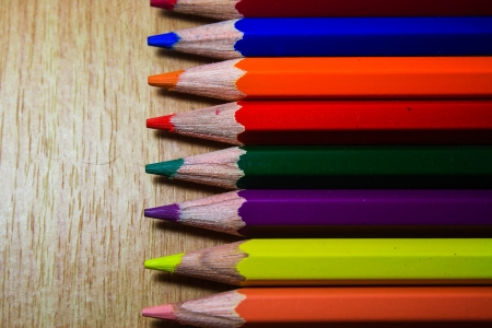 Color pencils on table it s isolate Stock Photo - 15682478