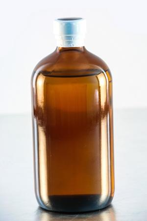 Bottle medicine glass on white background Stock Photo - 15842822