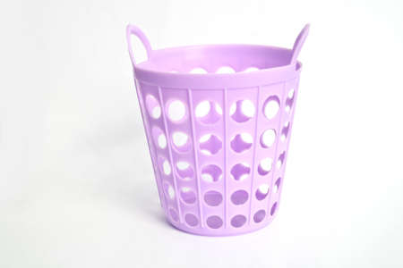 Plastic basket on white background