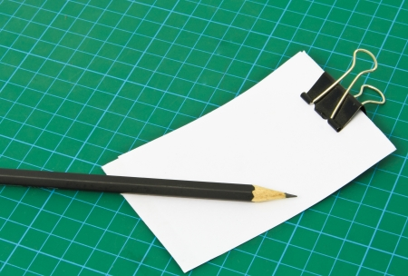 college ruled: Blank note on Cutting mat  Stock Photo