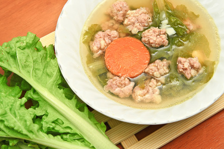 Soup with pork and vegetable in white bowl  Pork Soup  photo
