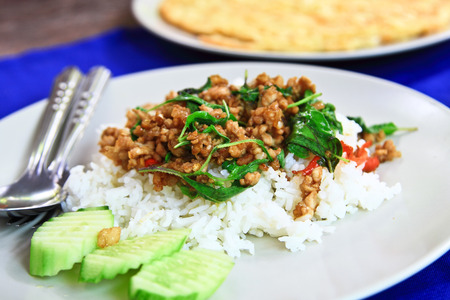 Thai spicy food fried basil pork with steamed rice(Krapao moo). photo