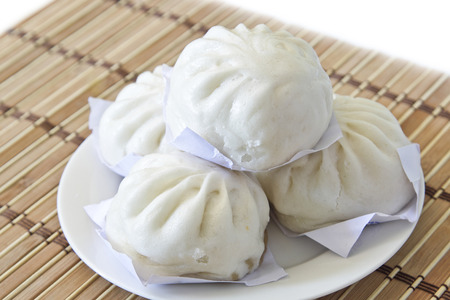 Chinese dumplings, Dim sum,steamed dumpling on white plate. Stock Photo