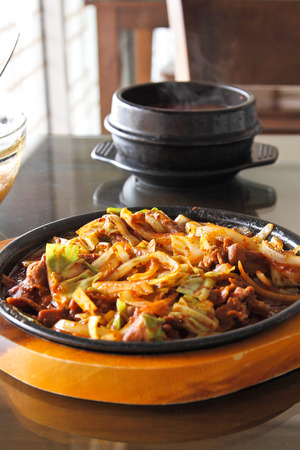 korean beef barbeque with rice cakes and rice on a side and Korean sauce  photo