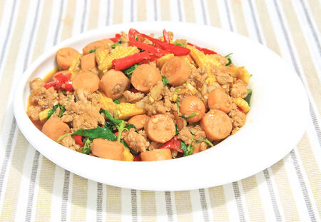 Thai spicy food,stir fried pork and sausage with basil. photo