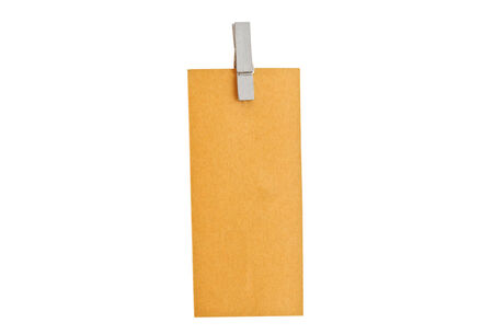 brown paper tag on pink background. photo