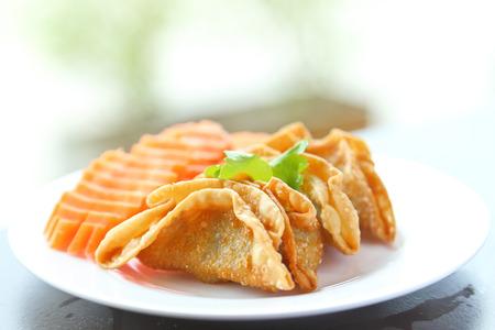 Fried Dumpling - Gyoza in white dish. photo
