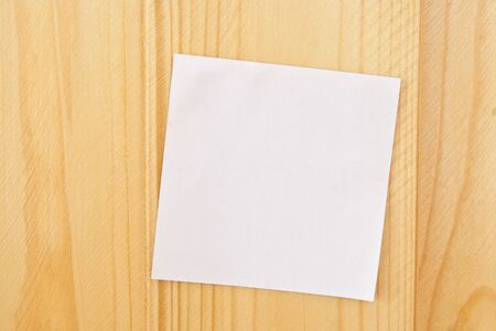 background texture: Empty white note paper on natural wooden background