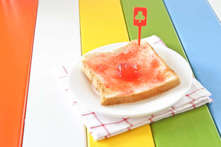 strawberry jam sandwich: Toast with strawberry jam on a white plate Stock Photo