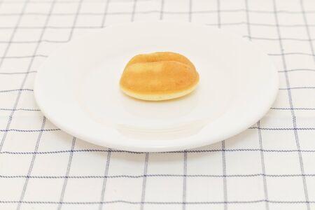 breadstick: Small bread on white dish. Stock Photo