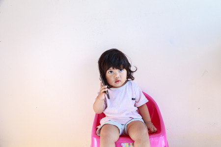 little girl playing with mobile phones.