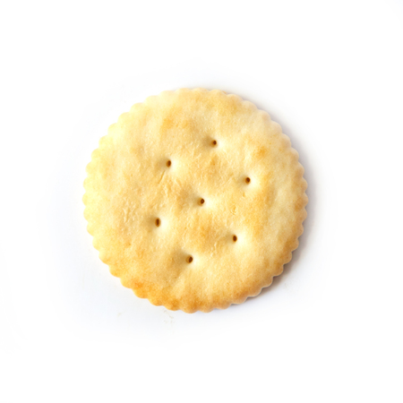 Dry cracker cookies isolated on white background