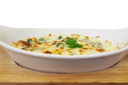 Baked Spinach with Cheese in white plate