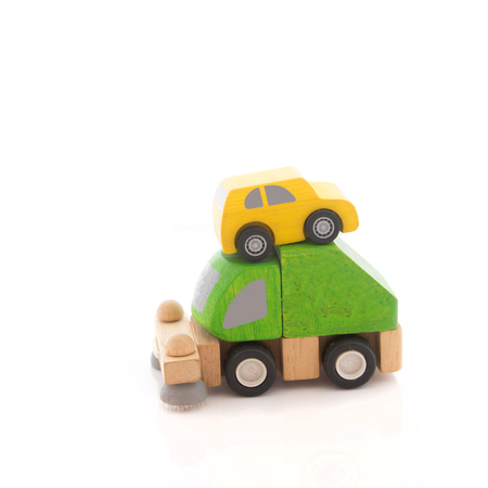 wooden car toy on white background.