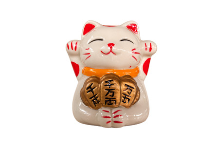 Japanese lucky cat on white background Фото со стока