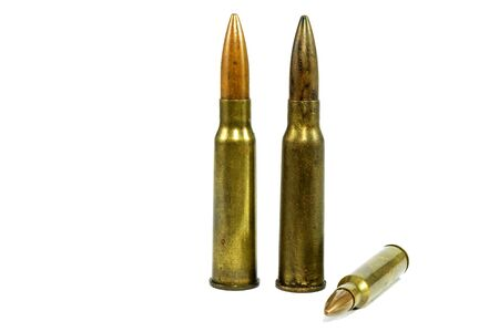 Two large ammunition balls and one small ammunition ball stacked with a white background. Stock Photo