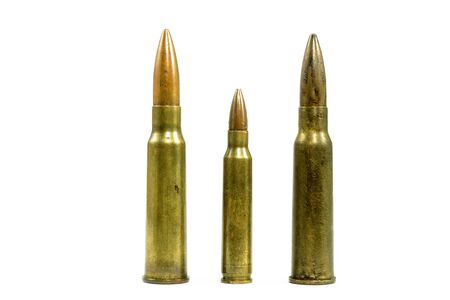The ammunitions are laid out in small and large blocks, placed on the floor with a white background. Stock fotó