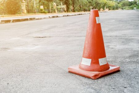 Traffic cones are located on the cement surface. In the park to protect the danger. Stock Photo