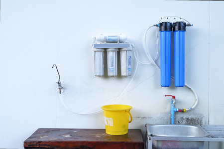 Great filters to purify your drinking water an image isolated in the kitchen interior