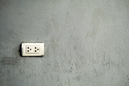 Electrical outlet Installed on a cemented background.