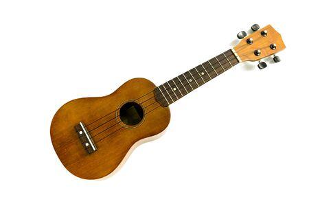 Brązowe ukulele na białym tle Zdjęcie Seryjne