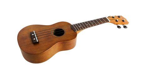 The brown ukulele on the white background
