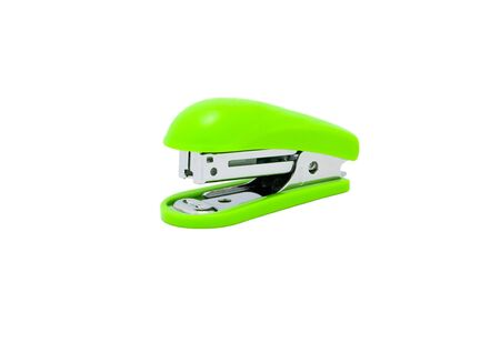 Stapler, office equipment green color isolated on a white background, with clipping path. 免版税图像