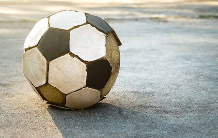 Old football on the concrete ground.