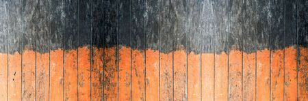 Vintage orange and black color painted wood wall as background or texture, Natural pattern. Blank copy space.