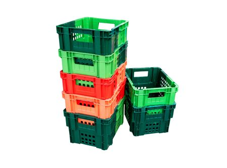 Green, red and orange color of plastic basket isolated on white background. File contains with clipping path.