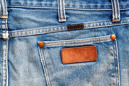 Close up of a blue jeans label. Blank jeans label to add text 免版税图像