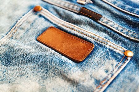 Selective focus and Soft focus / Close up of a blue jeans label. Blank jeans label to add text
