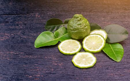 Fresh bergamot fruit and green leaf on wooden table background. Blank copy space