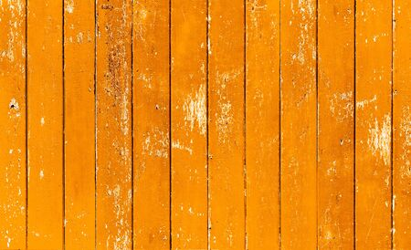Vintage wood board yellow color painted wood wall as background or texture, Natural pattern. Blank copy space.