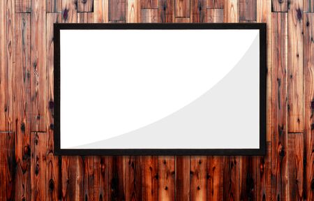 Black picture frame on dark brown wood panel wall detail as background, Natural pattern, Coming from natural tree. with blank copy space.